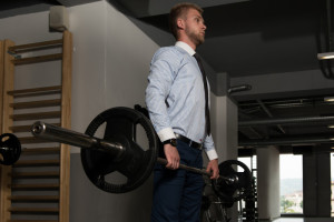 Businessman Doing Deadlifts