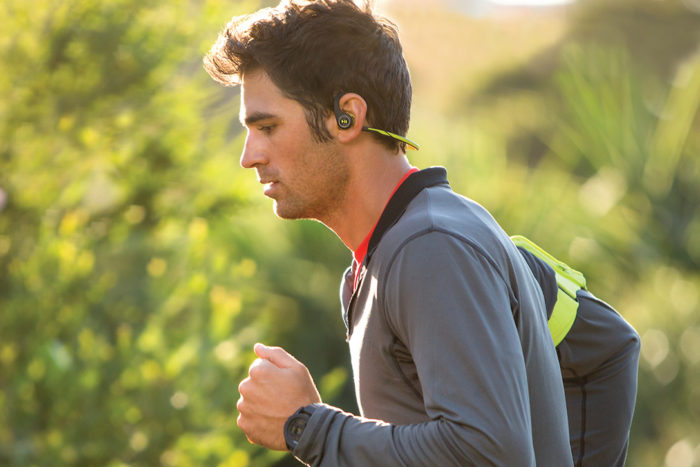 Young Man Running With Headphones